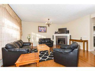Photo 3: 109 BRIDLERIDGE Heights SW in Calgary: Bridlewood House for sale : MLS®# C3650128