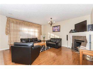 Photo 2: 109 BRIDLERIDGE Heights SW in Calgary: Bridlewood House for sale : MLS®# C3650128