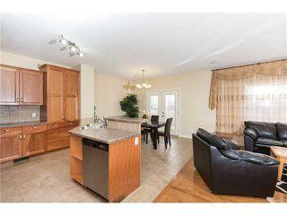 Photo 4: 109 BRIDLERIDGE Heights SW in Calgary: Bridlewood House for sale : MLS®# C3650128