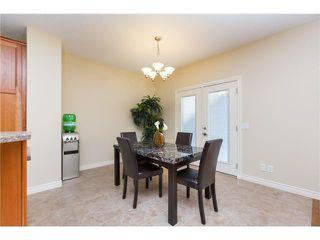 Photo 7: 109 BRIDLERIDGE Heights SW in Calgary: Bridlewood House for sale : MLS®# C3650128