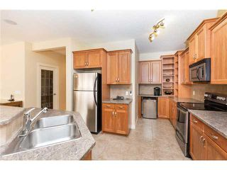 Photo 6: 109 BRIDLERIDGE Heights SW in Calgary: Bridlewood House for sale : MLS®# C3650128