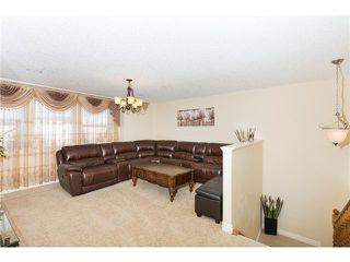 Photo 16: 109 BRIDLERIDGE Heights SW in Calgary: Bridlewood House for sale : MLS®# C3650128