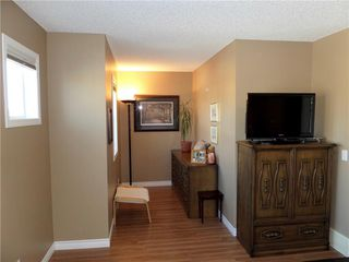 Photo 19: 309 DRAKE LANDING CL: Okotoks House for sale : MLS®# C4132769