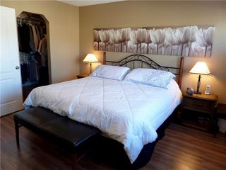 Photo 18: 309 DRAKE LANDING CL: Okotoks House for sale : MLS®# C4132769