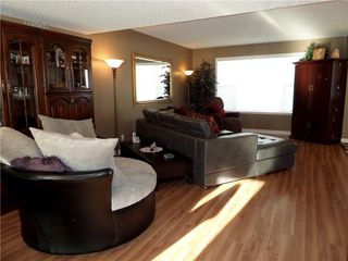 Photo 8: 309 DRAKE LANDING CL: Okotoks House for sale : MLS®# C4132769