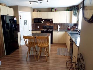 Photo 11: 309 DRAKE LANDING CL: Okotoks House for sale : MLS®# C4132769