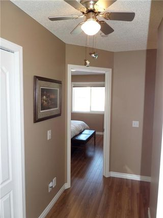 Photo 16: 309 DRAKE LANDING CL: Okotoks House for sale : MLS®# C4132769