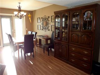 Photo 9: 309 DRAKE LANDING CL: Okotoks House for sale : MLS®# C4132769