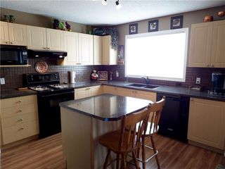 Photo 13: 309 DRAKE LANDING CL: Okotoks House for sale : MLS®# C4132769