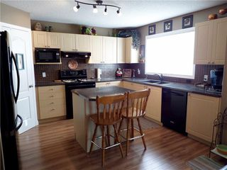 Photo 12: 309 DRAKE LANDING CL: Okotoks House for sale : MLS®# C4132769
