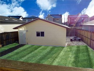 Photo 36: 309 DRAKE LANDING CL: Okotoks House for sale : MLS®# C4132769