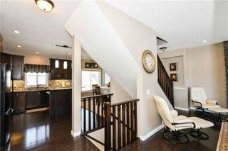 Photo 16: 304 CIMARRON VISTA Way: Okotoks House for sale : MLS®# C4172513