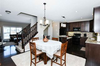 Photo 12: 304 CIMARRON VISTA Way: Okotoks House for sale : MLS®# C4172513