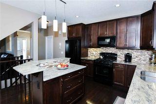Photo 7: 304 CIMARRON VISTA Way: Okotoks House for sale : MLS®# C4172513