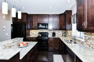 Photo 8: 304 CIMARRON VISTA Way: Okotoks House for sale : MLS®# C4172513