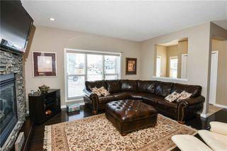 Photo 4: 304 CIMARRON VISTA Way: Okotoks House for sale : MLS®# C4172513