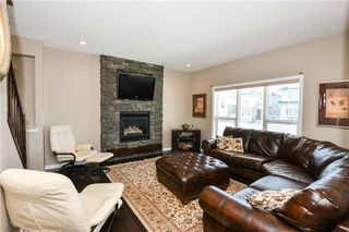 Photo 2: 304 CIMARRON VISTA Way: Okotoks House for sale : MLS®# C4172513