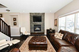 Photo 3: 304 CIMARRON VISTA Way: Okotoks House for sale : MLS®# C4172513