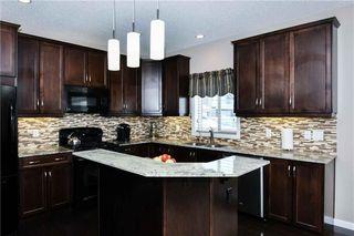 Photo 6: 304 CIMARRON VISTA Way: Okotoks House for sale : MLS®# C4172513