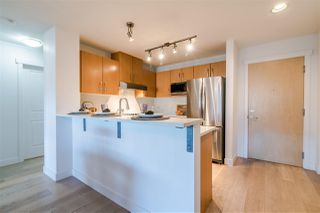 "Photo 4: 201 500 KLAHANIE Drive in Port Moody: Port Moody Centre Condo for sale in ""TIDES"" : MLS®# R2387501"