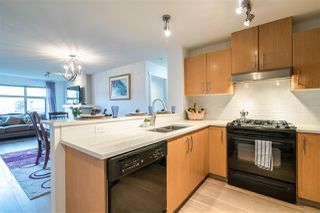 "Photo 3: 201 500 KLAHANIE Drive in Port Moody: Port Moody Centre Condo for sale in ""TIDES"" : MLS®# R2387501"