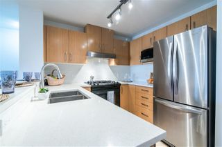 "Photo 2: 201 500 KLAHANIE Drive in Port Moody: Port Moody Centre Condo for sale in ""TIDES"" : MLS®# R2387501"