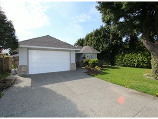 Photo 1: 6393 190TH Street in Surrey: Cloverdale BC House for sale (Cloverdale)  : MLS®# F1405826