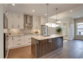 Photo 2: 3715 43 Street SW in Calgary: Glenbrook House for sale : MLS®# C4027438