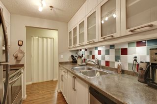 Photo 5: 106 819 4A Street NE in Regal Manor: Apartment for sale : MLS®# C3611396