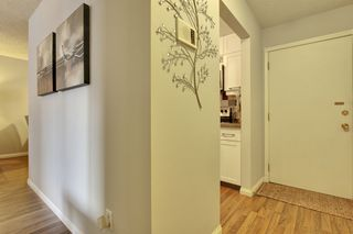Photo 2: 106 819 4A Street NE in Regal Manor: Apartment for sale : MLS®# C3611396