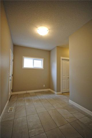 Photo 11: 58 CANALS Close SW: Airdrie House for sale : MLS®# C4108253
