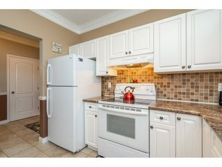 "Photo 9: 202 5489 201 Street in Langley: Langley City Condo for sale in ""CANIM COURT"" : MLS®# R2284285"
