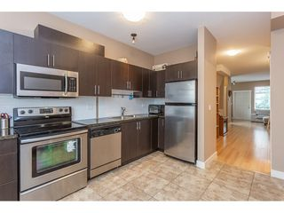 """Photo 3: 40 13899 LAUREL Drive in Surrey: Whalley Townhouse for sale in """"Emerald Gardens"""" (North Surrey)  : MLS®# R2327944"""