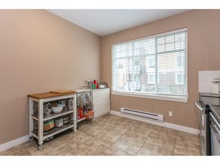 """Photo 5: 40 13899 LAUREL Drive in Surrey: Whalley Townhouse for sale in """"Emerald Gardens"""" (North Surrey)  : MLS®# R2327944"""