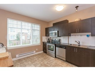 """Photo 4: 40 13899 LAUREL Drive in Surrey: Whalley Townhouse for sale in """"Emerald Gardens"""" (North Surrey)  : MLS®# R2327944"""