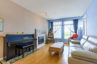 "Photo 3: 305 15385 101A Avenue in Surrey: Guildford Condo for sale in ""Charlton Park"" (North Surrey)  : MLS®# R2375782"