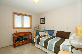 Photo 17: 185 WEST MCDOUGAL Road: Cochrane House for sale : MLS®# C4184033