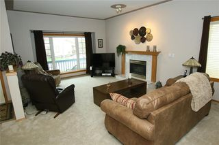Photo 4: 185 WEST MCDOUGAL Road: Cochrane House for sale : MLS®# C4184033