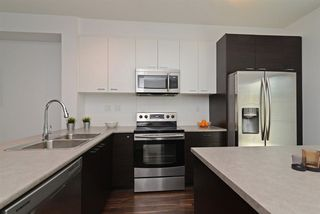 """Photo 5: 51 3010 RIVERBEND Drive in Coquitlam: Coquitlam East Townhouse for sale in """"WESTWOOD"""" : MLS®# R2292574"""