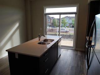 Photo 3: 17 1636 Kerr Road in Edmonton: Zone 27 Townhouse for sale : MLS®# E4142512