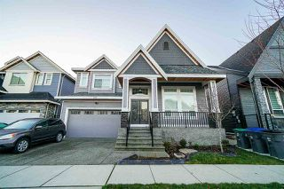 Main Photo: 6977 149 Street in Surrey: East Newton House for sale : MLS®# R2358438
