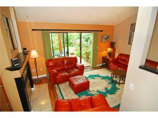 Photo 2: 8580 Woodgrove Place in Burnaby: Forest Hills BN Condo for sale (Burnaby North)  : MLS®# V1003573