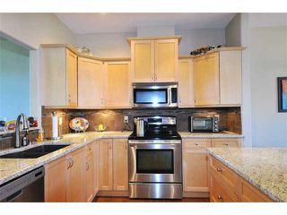"Photo 2: 2 23281 KANAKA Way in Maple Ridge: Cottonwood MR Townhouse for sale in ""WOODRIDGE"" : MLS®# V1032160"