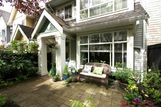 "Photo 1: 7430 MAGNOLIA Terrace in Burnaby: Highgate Townhouse for sale in ""CAMARILLO"" (Burnaby South)  : MLS®# R2080942"