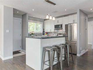 Photo 3: 75 WHITMAN Crescent NE in Calgary: Whitehorn House for sale : MLS®# C4074326