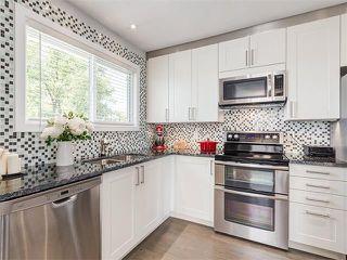 Photo 4: 75 WHITMAN Crescent NE in Calgary: Whitehorn House for sale : MLS®# C4074326