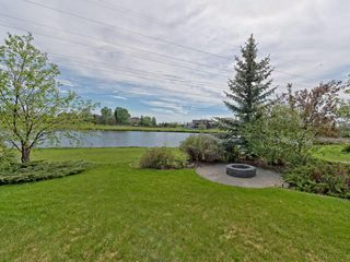 Photo 4: 167 LAKESIDE GREENS Court: Chestermere House for sale : MLS®# C4120469