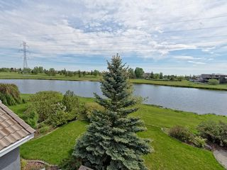 Photo 2: 167 LAKESIDE GREENS Court: Chestermere House for sale : MLS®# C4120469