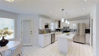 Photo 10: 307 ROCKY RIDGE Cove NW in Calgary: Rocky Ridge Detached for sale : MLS®# C4186420