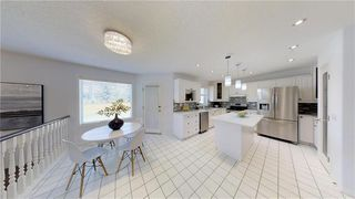 Photo 12: 307 ROCKY RIDGE Cove NW in Calgary: Rocky Ridge Detached for sale : MLS®# C4186420